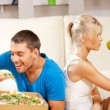Couple eating different food — Stock Photo #13181033