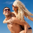 Happy couple in sunglasses on the beach — Stock Photo #13181047