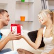 Happy romantic couple with gift - Stock Photo