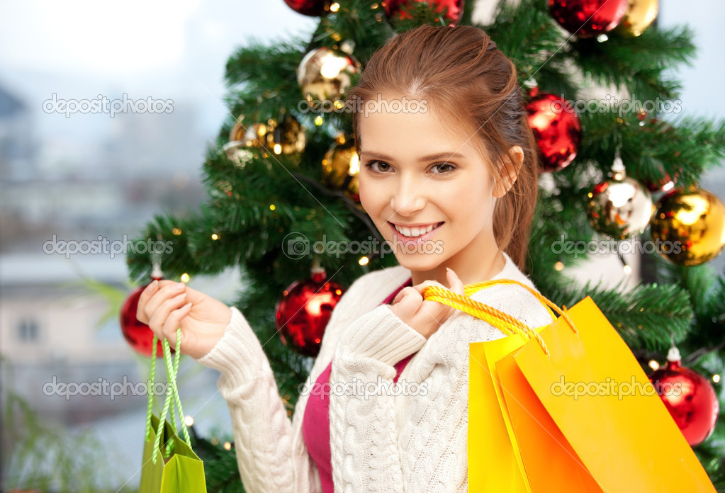 Bright picture of happy woman with shopping bags and christmas tree.....  Stock Photo #13181214