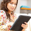 Calm woman with tablet pc computer — Stock Photo #13220661