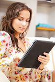 Calm woman with tablet pc computer — Stock Photo