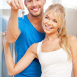 Happy couple with keys — Stock Photo
