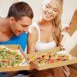 Romantic couple eating pizza at home — Stock Photo #13259137