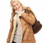 Woman in sheepskin jacket — Stock Photo #13260068