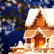 Gingerbread house over christmas background - Lizenzfreies Foto