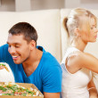Couple eating different food — Stock Photo #13299992