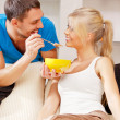 Happy couple at home — Stockfoto