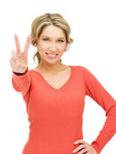 Young woman showing victory sign — Stock Photo