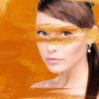 Woman with orange paint - Stock Photo