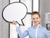 Smiling businesswoman with blank text bubble — Stock Photo