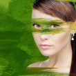 Woman with green paint - Stock Photo