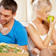 Couple eating different food — Stock Photo