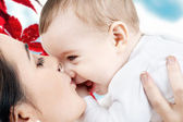 Happy mother kissing baby boy — Foto Stock