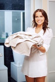 Smiling teenage girl with towels — Stock Photo