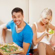 Couple eating different food — Stock Photo #13516296