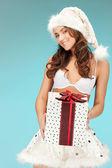 Santa helper girl in lingerie with gift box — Stock Photo