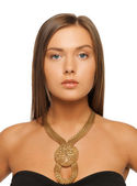 Beautiful woman with necklace — Stok fotoğraf