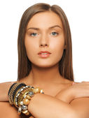 Beautiful woman with bracelets — Stockfoto