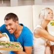 Couple eating different food - Stok fotoğraf