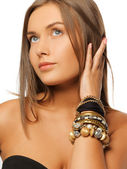 Beautiful woman with bracelets — Stock fotografie