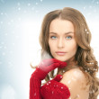 Royalty-Free Stock Photo: Beautiful woman in red mittens