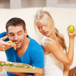 Couple eating different food — Stock Photo #13636667