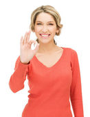 Young woman showing ok sign — Stok fotoğraf