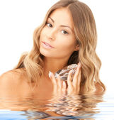 Lovely woman with big diamond in water — Stock Photo