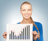 Woman with growth graph on board — Stock Photo