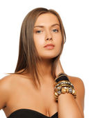 Beautiful woman with bracelets — Stok fotoğraf