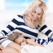 Happy mother and sleeping girl — Stock Photo #13798631