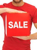 Man med försäljning tecken — Stockfoto