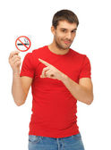 Man in red shirt with no smoking sign — Stockfoto