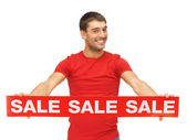 Handsome man with sale sign — Stock Photo