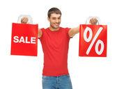 Hombre con bolsas de compras — Foto de Stock