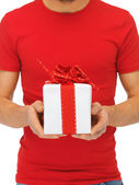 Man's hands holding gift box — Stock Photo