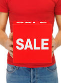 Man's hands holding sale sign — Стоковое фото