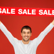 Stock Photo: Handsome mwith sale sign
