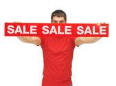 Man holding sale sign — Stockfoto