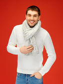 Handsome man in warm sweater and scarf — Stock Photo