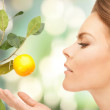 Lovely woman with lemon twig — Stock Photo #13943458