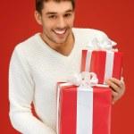 Man holding many gift boxes — Stock Photo #13944271
