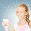 Lovely teenage girl with piggy bank — Stock Photo #13945115
