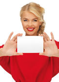 Lovely woman in red dress with note card — Stock Photo