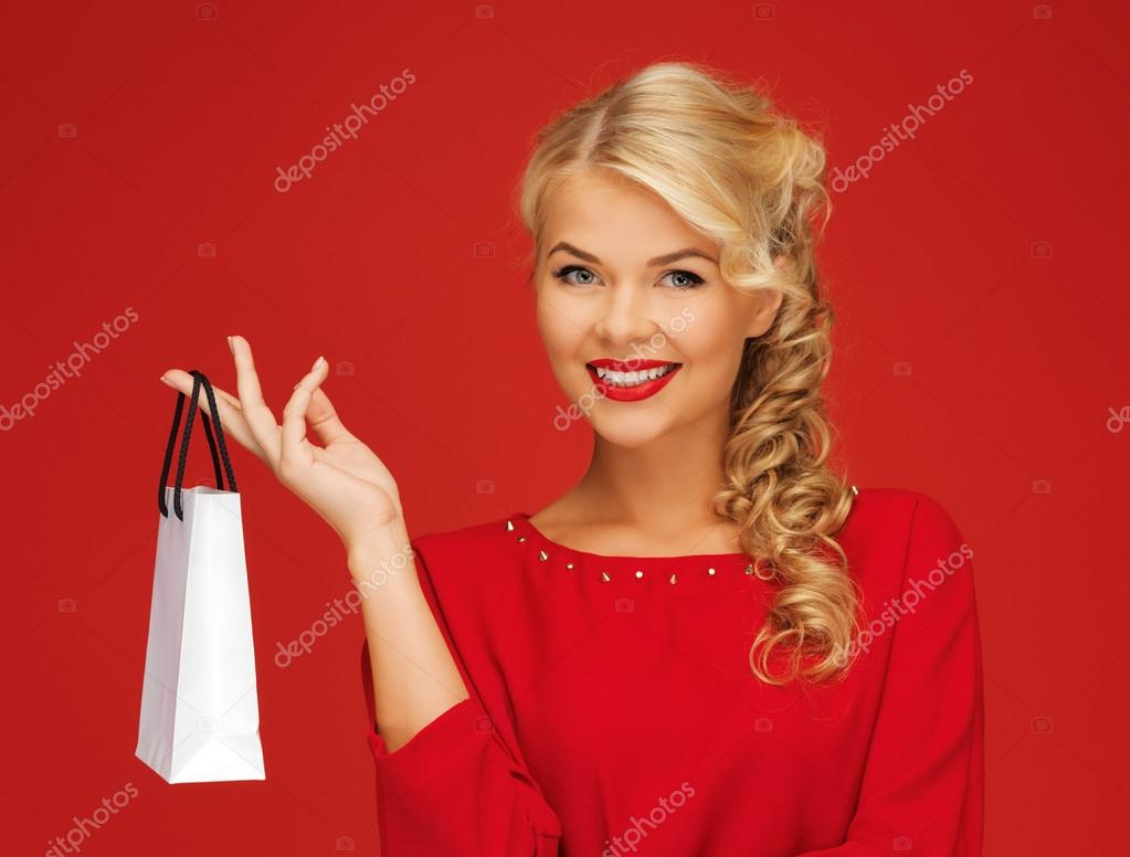 Picture of lovely woman in red dress with shopping bag — Stock Photo #14016969