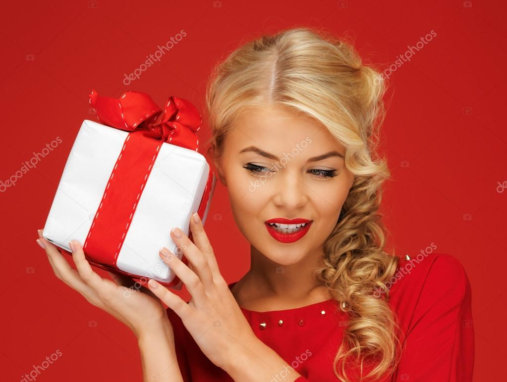 Picture of lovely woman in red dress with present — Stock Photo #14020277