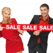 Man and woman with sale sign — Stock Photo #14030939