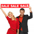 Stock Photo: Man and woman with sale sign