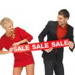 Man and woman with sale sign — Stock Photo #14094382